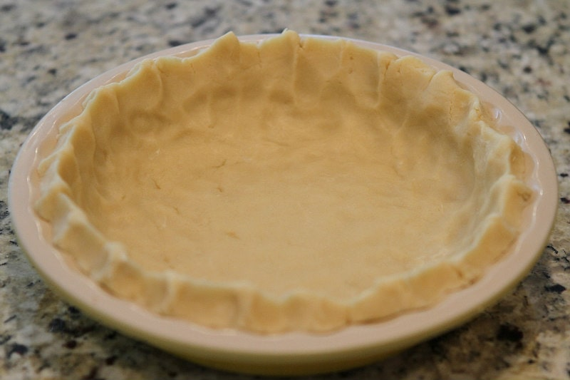 Cream Cheese Pie Crust pressed into a pie plate before baking