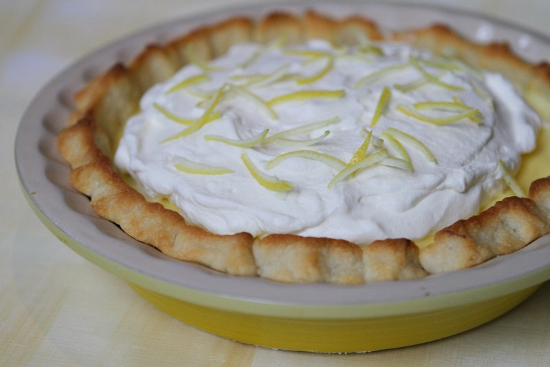 Lemon Sour Cream Pie in a yellow pie plate