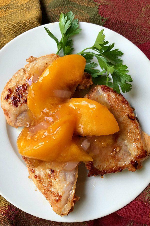 Pork with Peach Sauce on a white plate