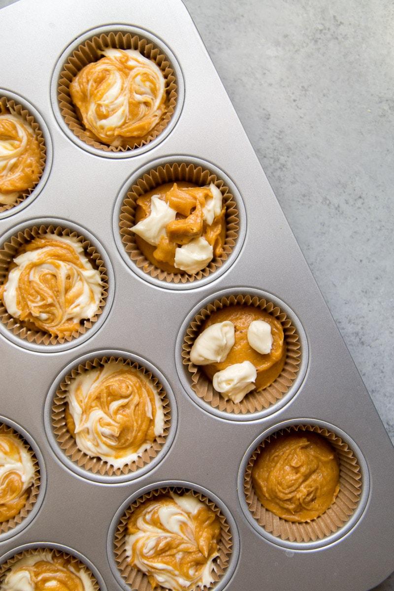 Pumpkin Cream Cheese Muffins in the muffin pan