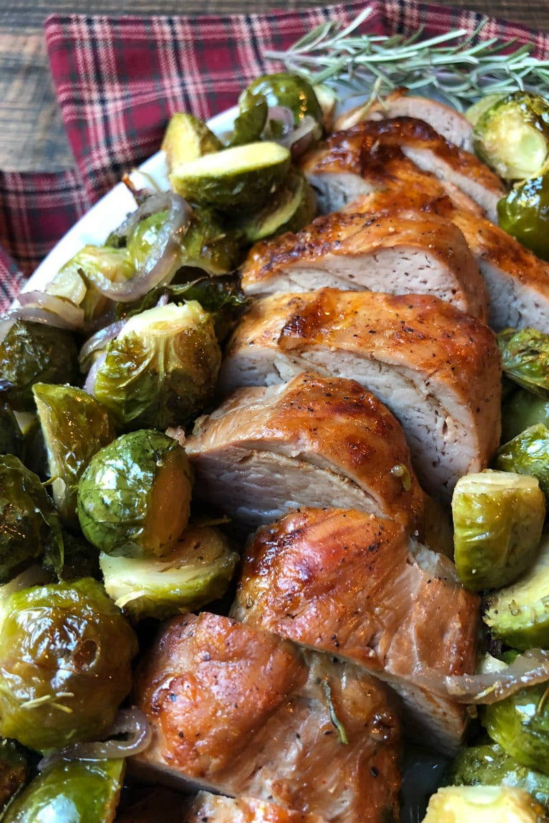 Sheet Pan Pork Tenderloin with Maple Rosemary Brussels Sprouts on a serving platter