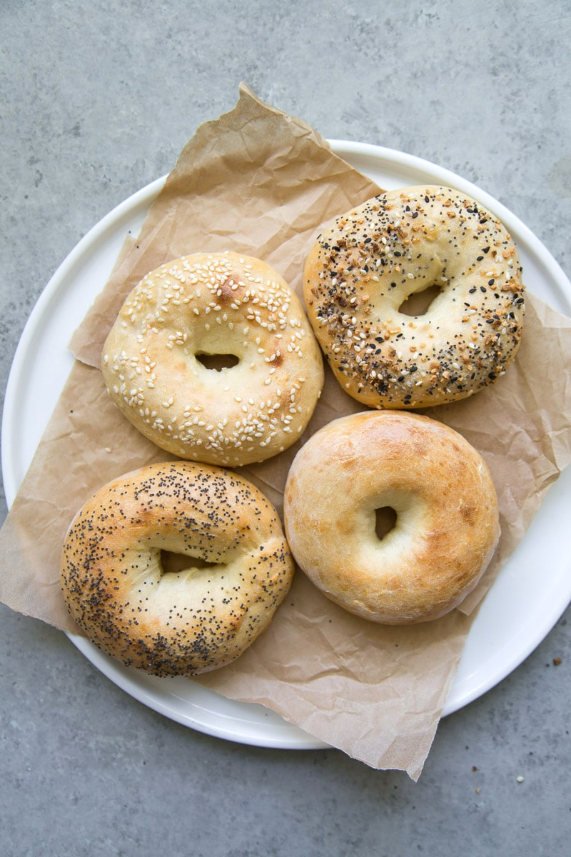 overhead shot of 2 Ingredient Bagels on a white plate lined with parchment paper