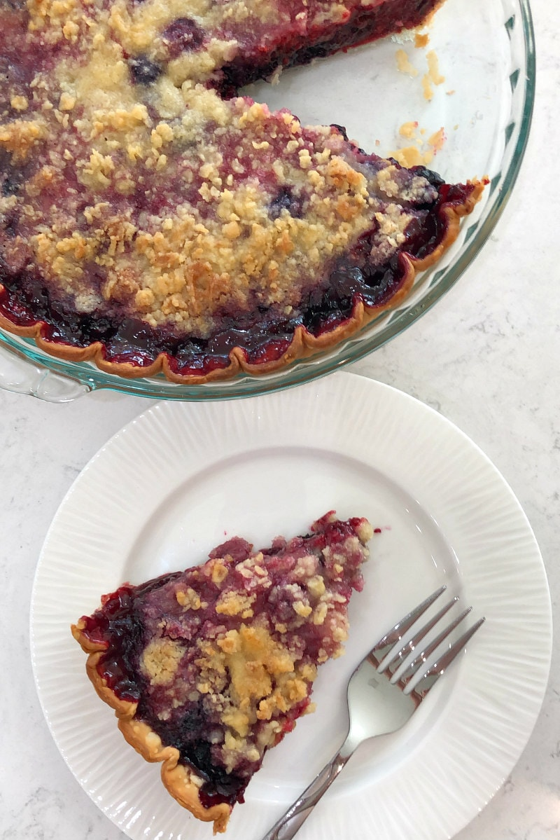 Slice of three berry pie