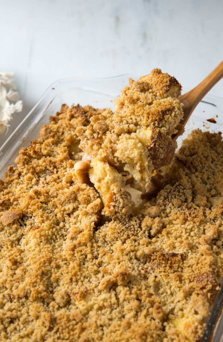 a spoon serving peach cobbler french toast casserole