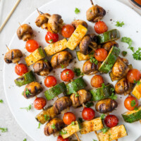 chipotle glazed vegetable kabobs on a white plate