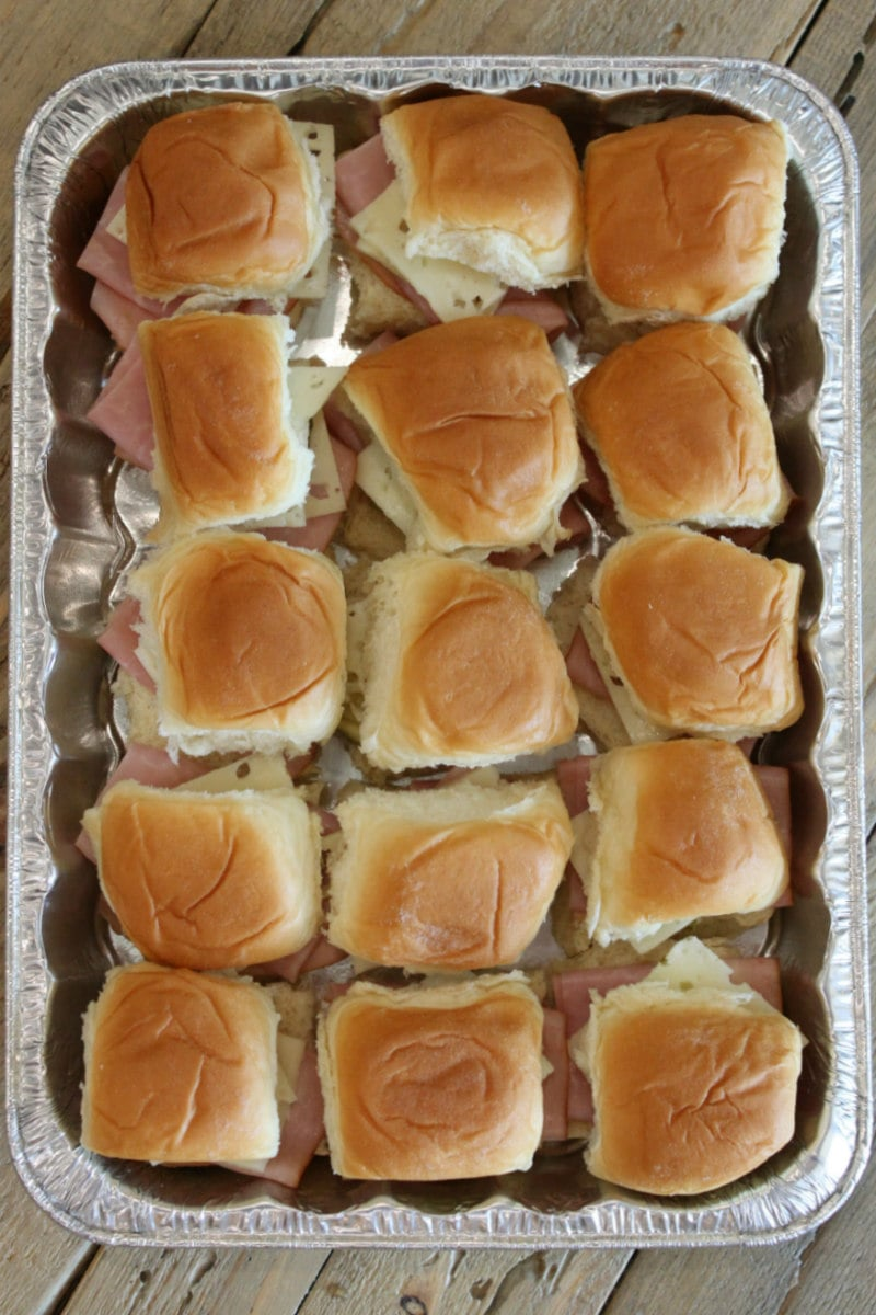 overhead shot of a pan of cuban sliders ready for the oven