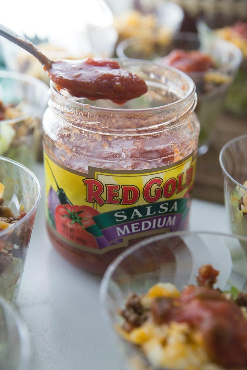 Adding salsa to Easy Taco Salad Cups