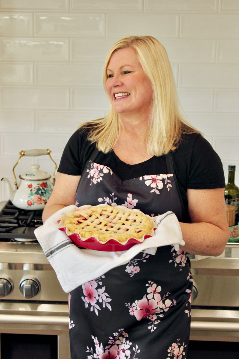 RecipeGirl holding a Cranberry Pie