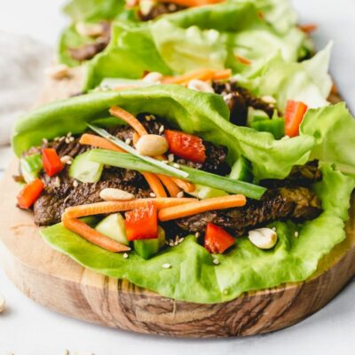 bulgogi beef lettuce wraps on a wooden cutting board