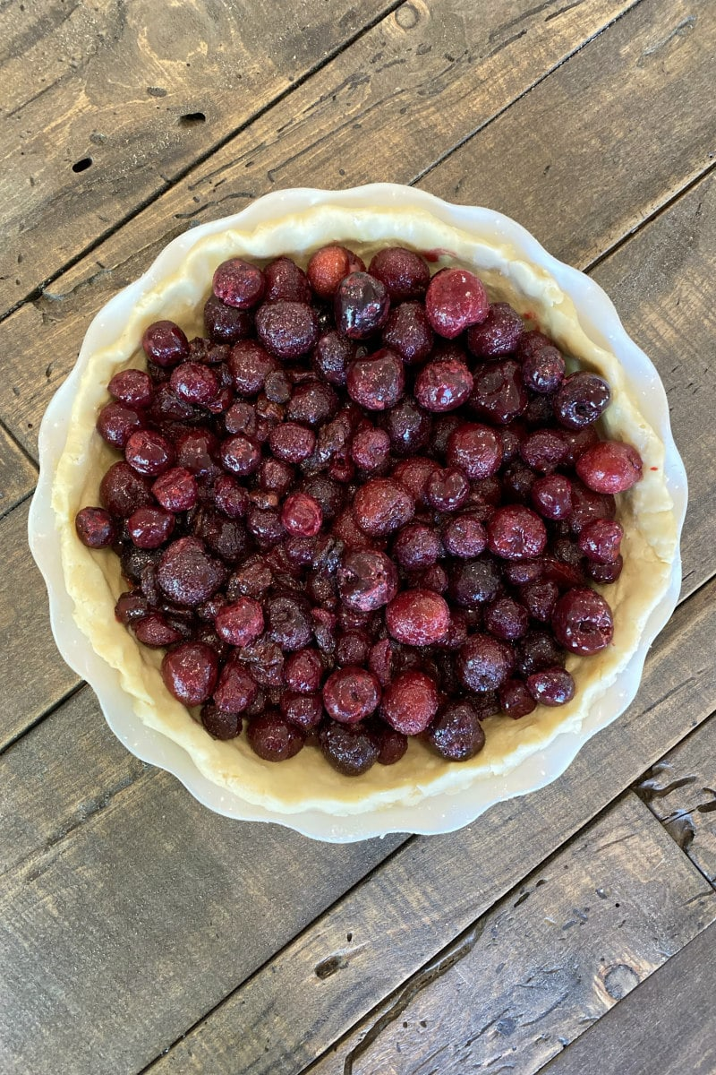 overhead shot of cherries in pie crust
