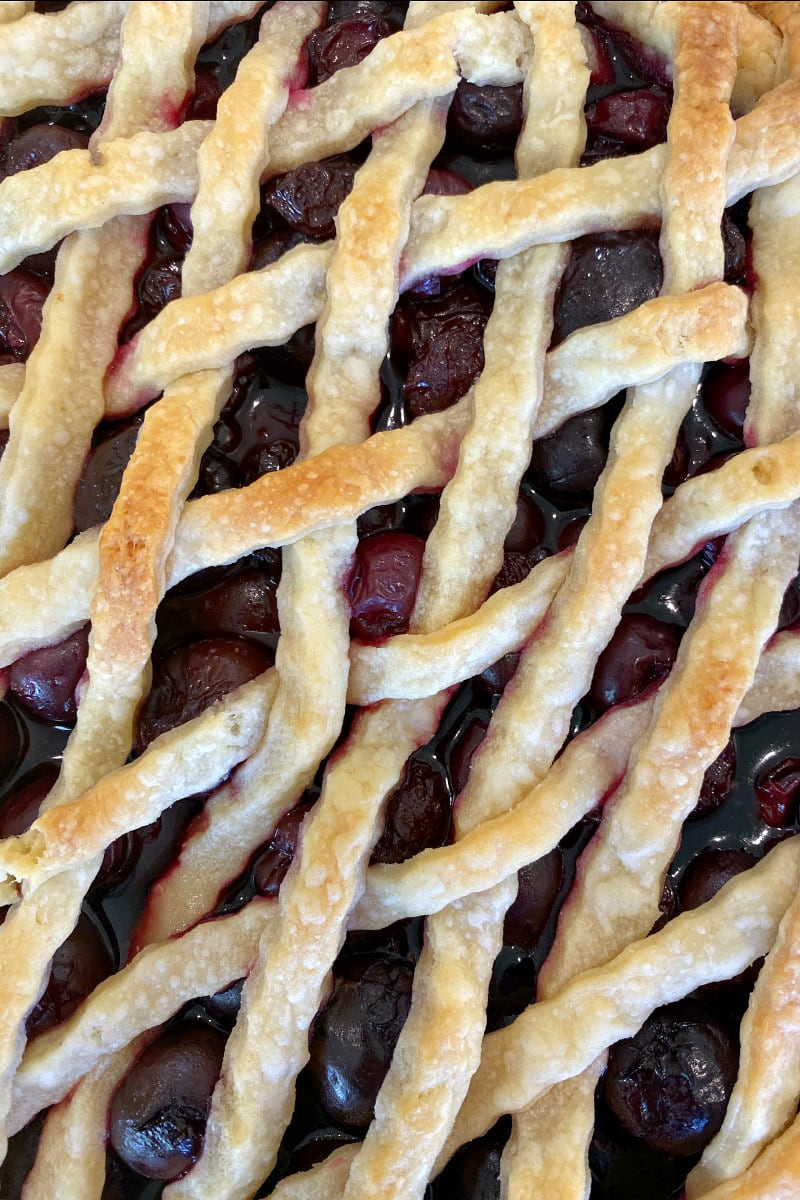 overhead shot of cherry pie with lattice crust topping