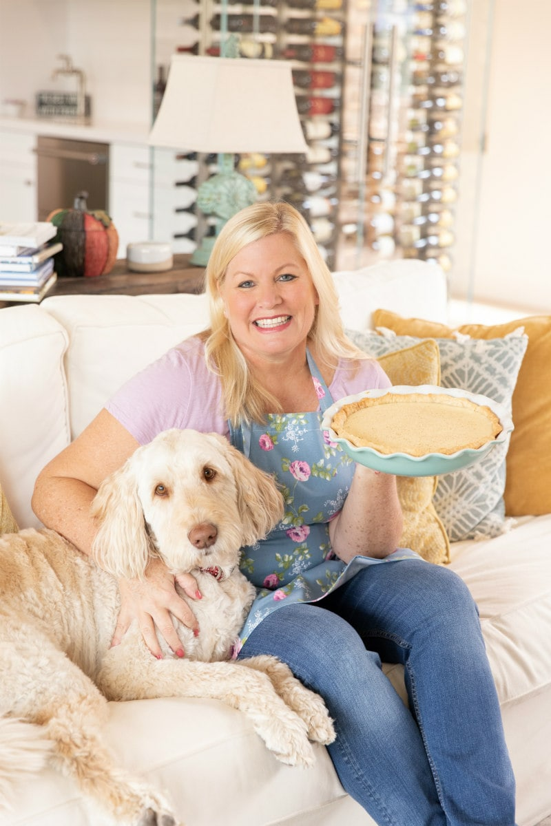 RecipeGirl and Tessie the labradoodle with pie