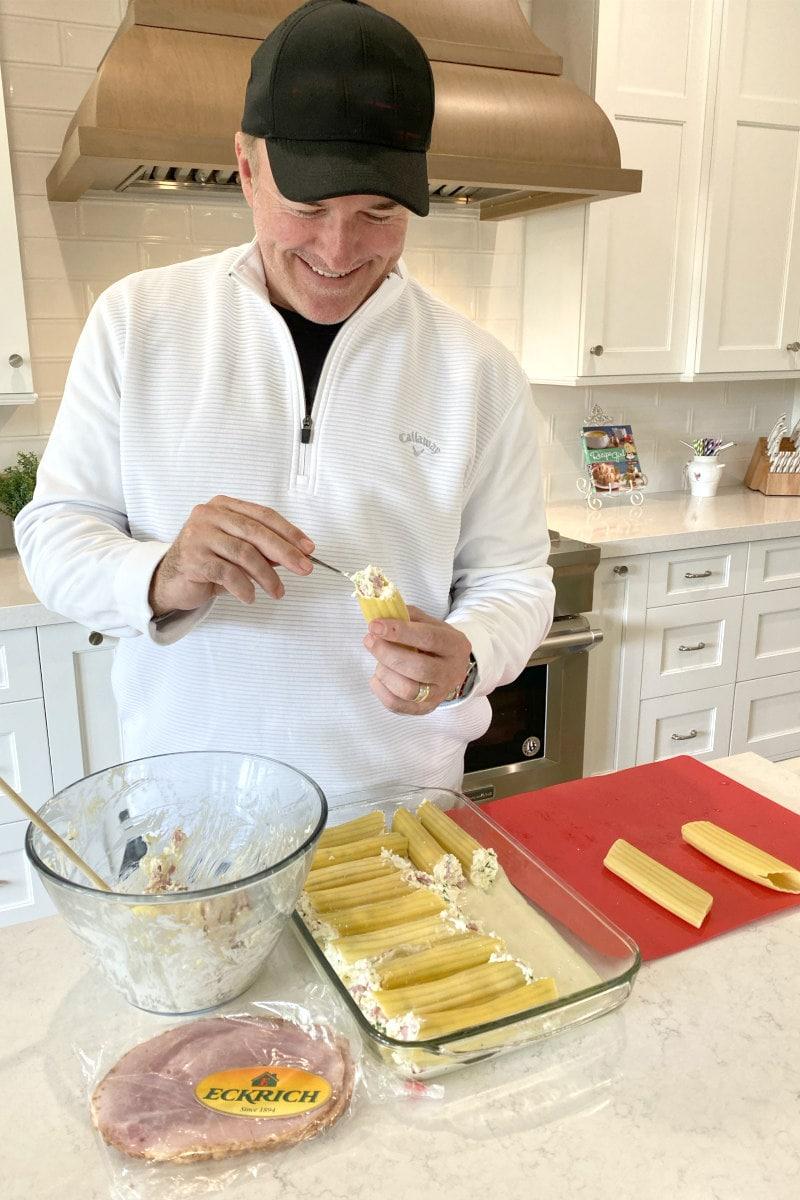 RecipeGirl's husband stuffing manicotti