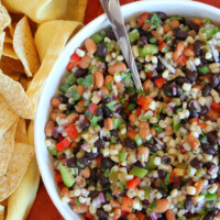 overhead shot of texas caviar in a white bowl served with tortilla chips