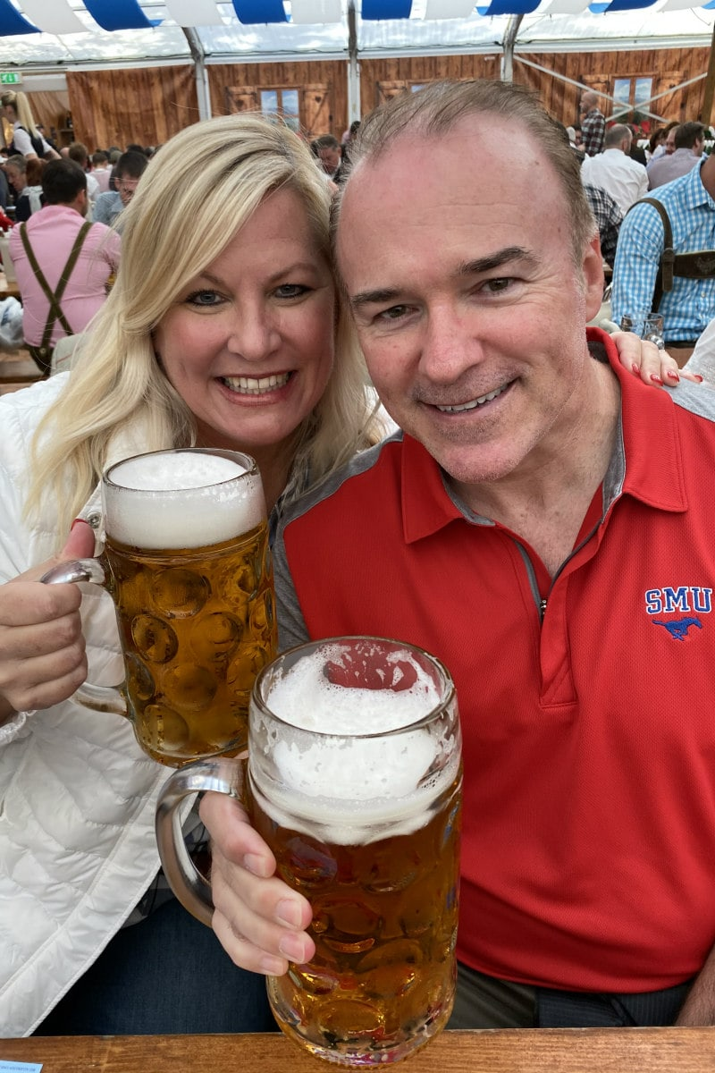 Oktoberfest in Zurich, Switzerland: RecipeGirl and husband with big mugs of beer