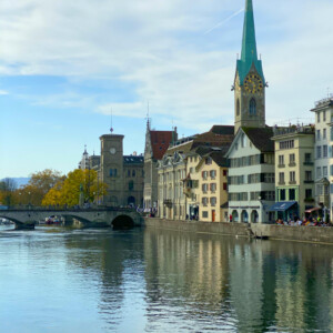 looking down the river in zurich switzerland with buildings on the side of the river