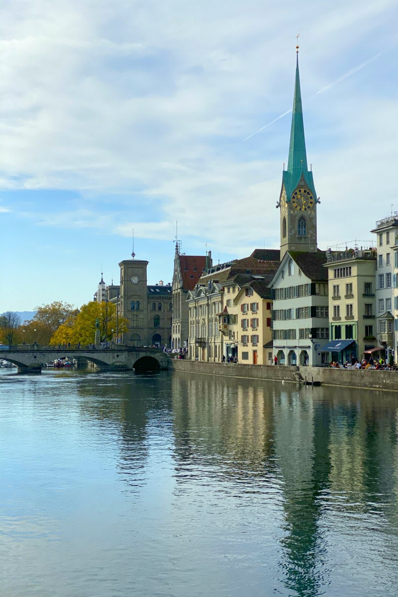 bridge and river in Zurich with buildings in background