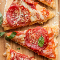weight watchers pepperoni pizza slices on a cutting board