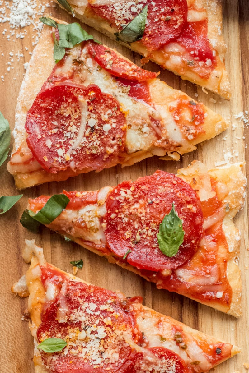 Slices of Weight Watchers pepperoni Pizza on a cutting board