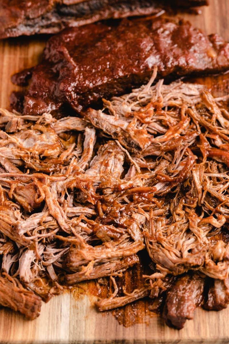 shredded barbecue beef on a cutting board