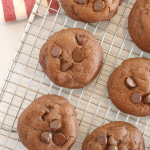 chocolate chocolate chip pudding cookies cooling on a cooling rack