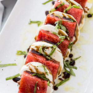 watermelon caprese salad on a white plate