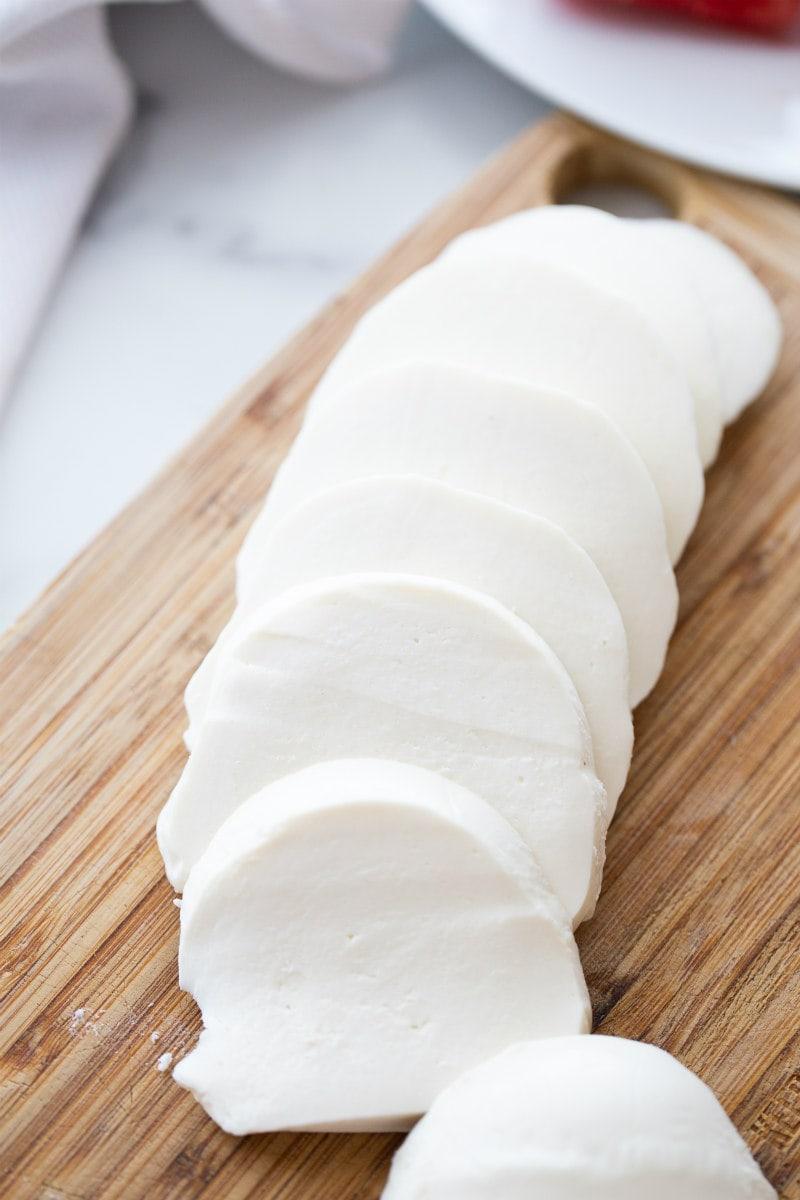 slices of fresh mozzarella on a cutting board