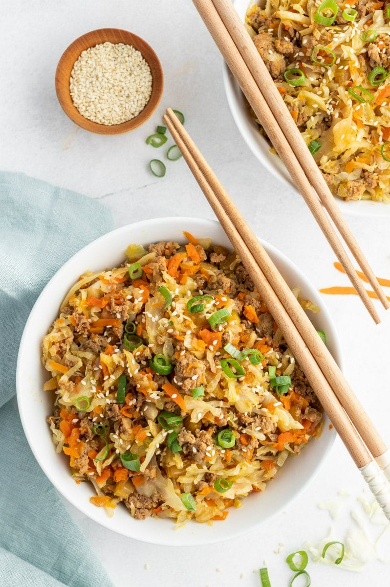 egg roll in a bowl with chopsticks on top