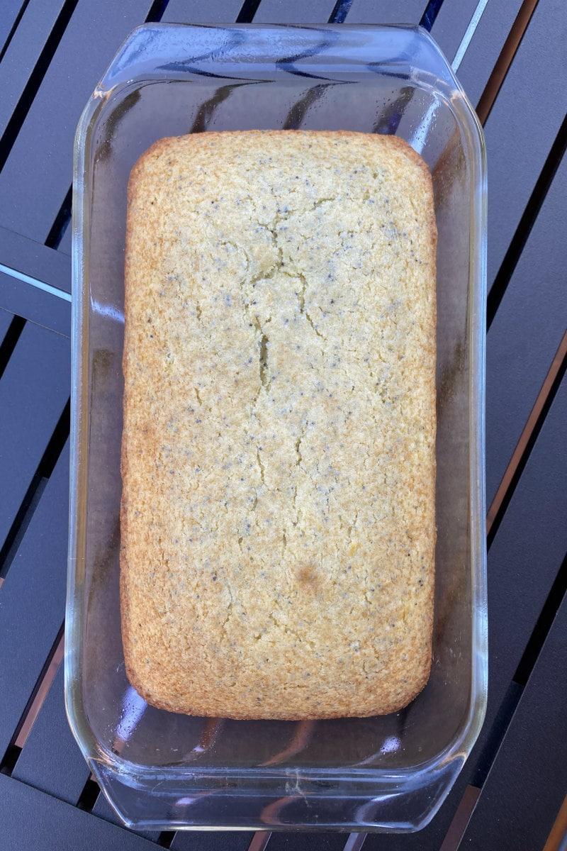 overhead shot of loaf of lemon poppy seed bread in a pyrex pan