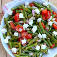 green bean salad in a white bowl