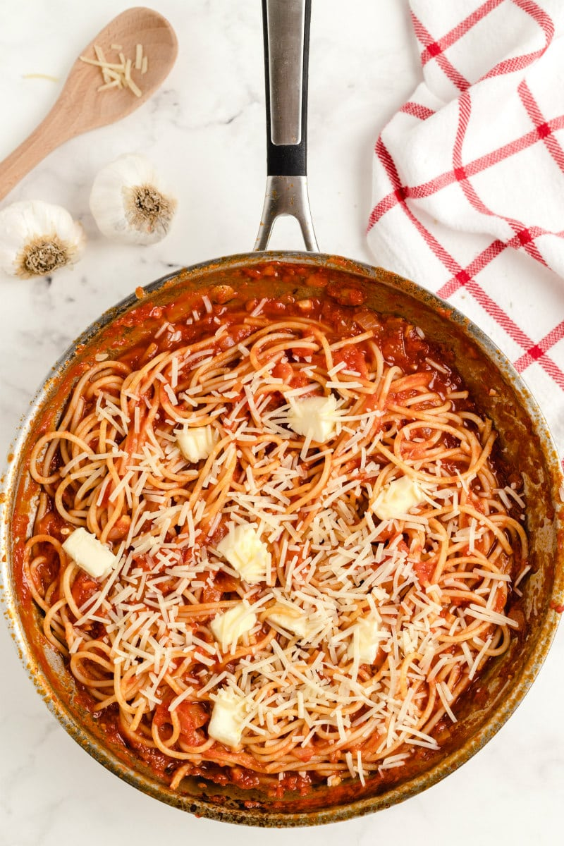 pasta pomodoro in a pan with butter and parmesan