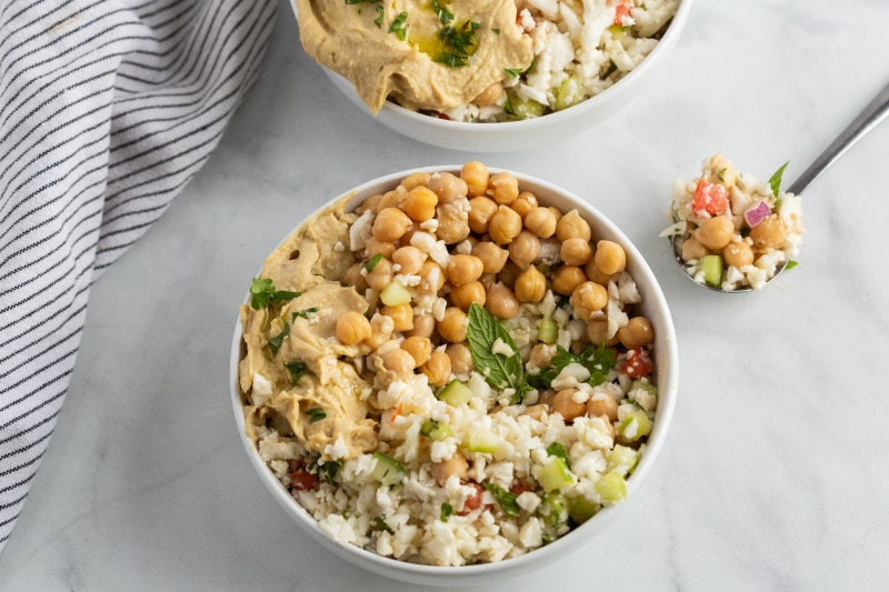 Cauliflower Tabbouleh Bowl with a spoonful sitting alongside
