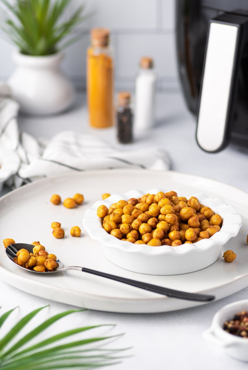 air fryer chickpeas in a bowl with a spoon