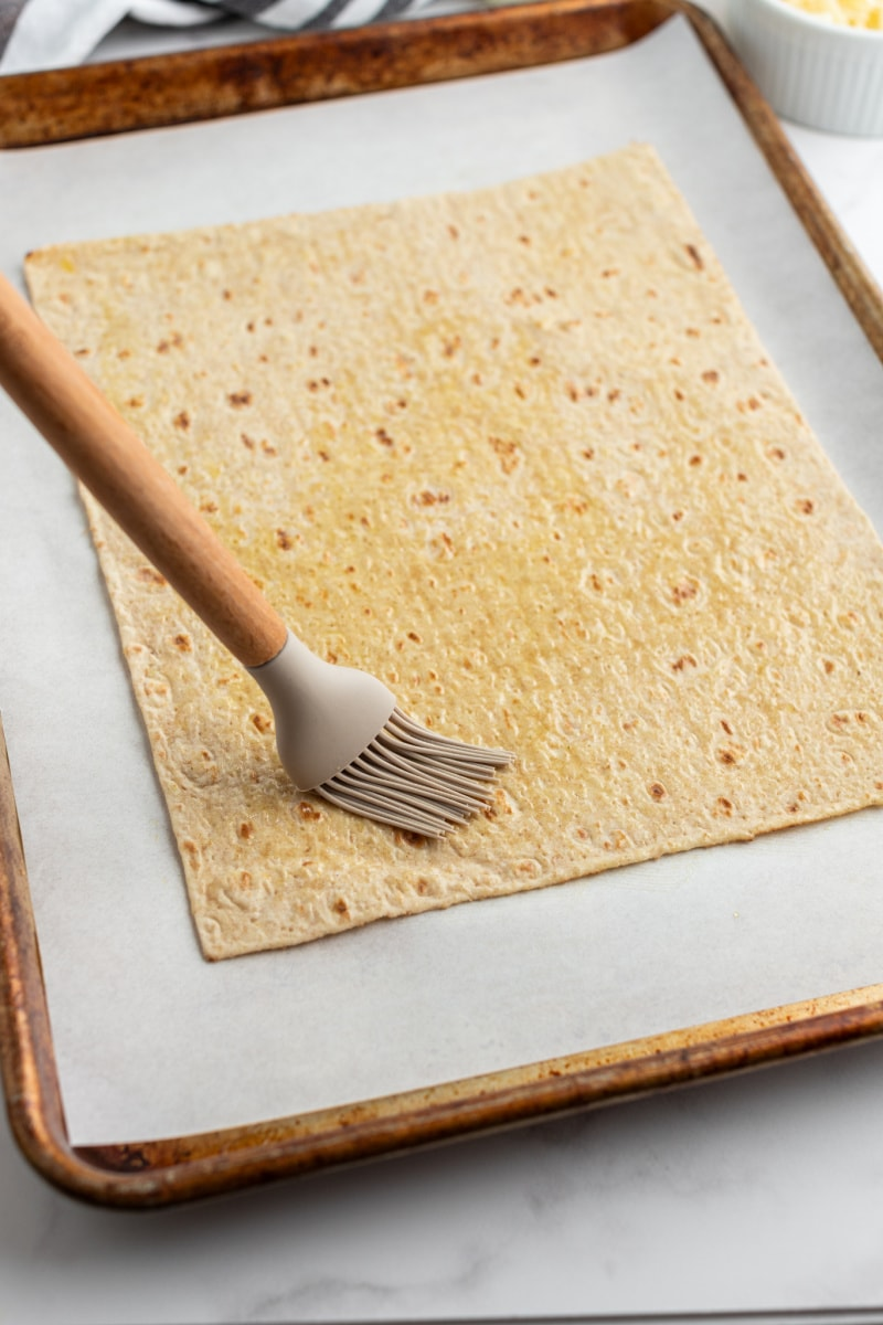 brushing lavash flatbread with oil