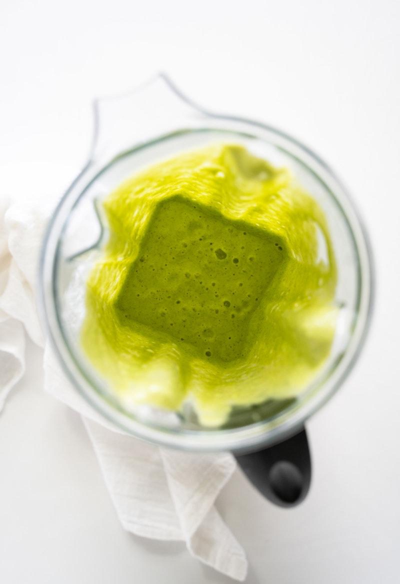 green smoothie blended up in blender