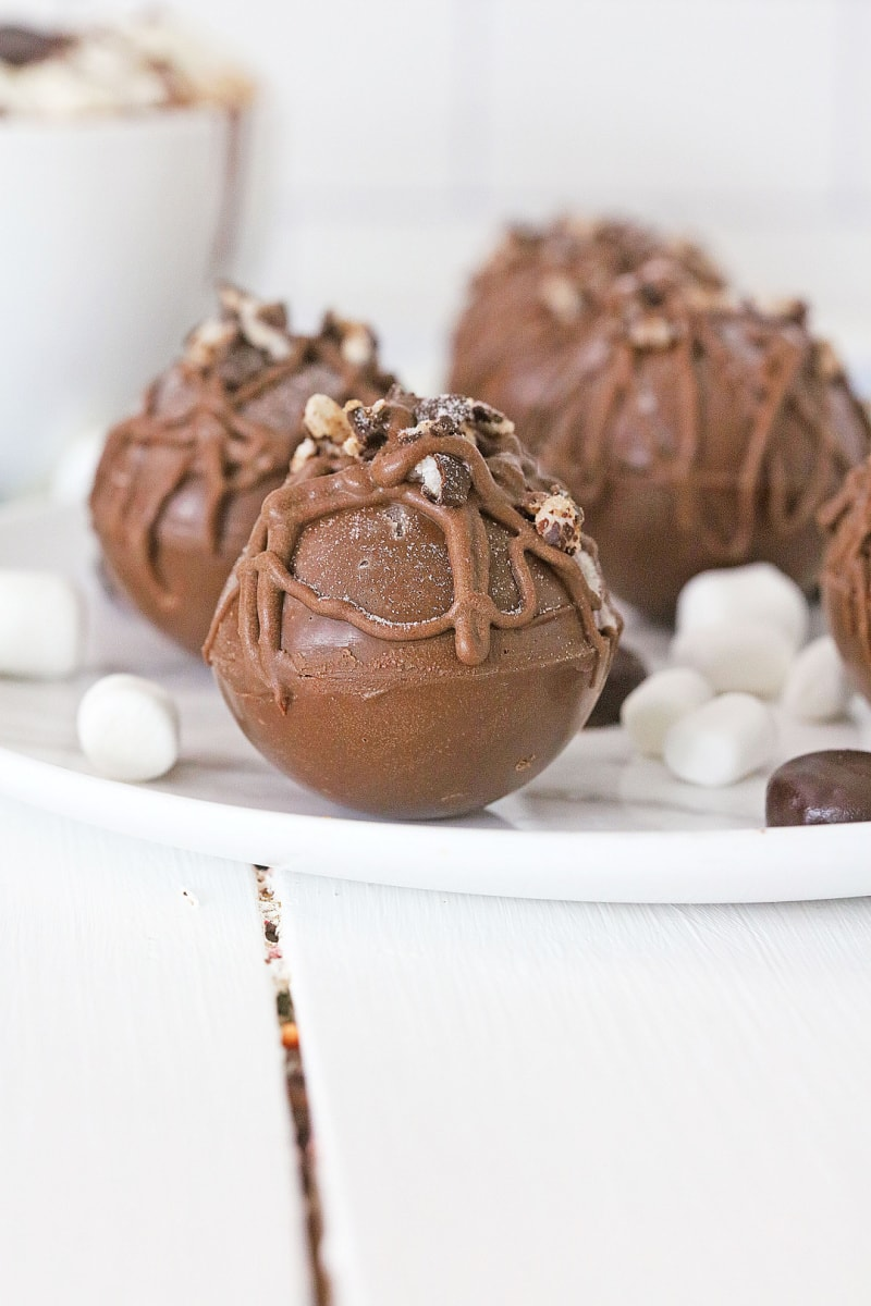 hot chocolate bombs on a white plate