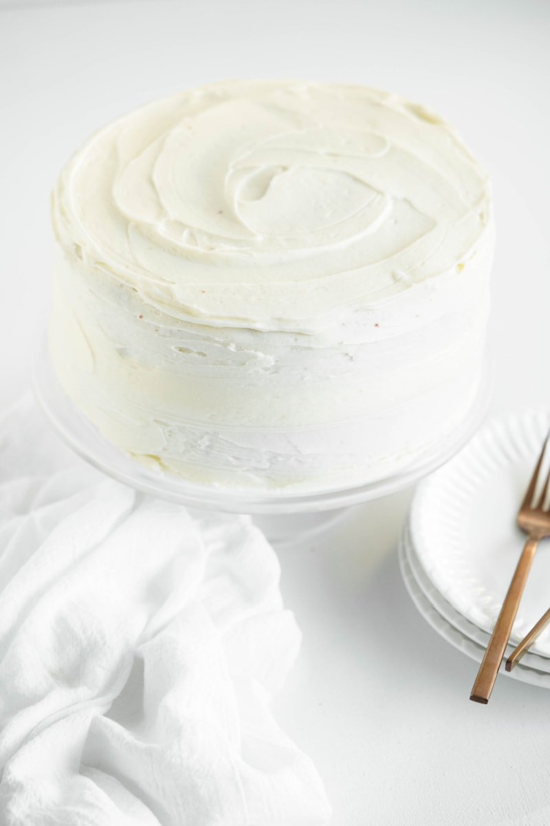 cake with white frosting on cake platter