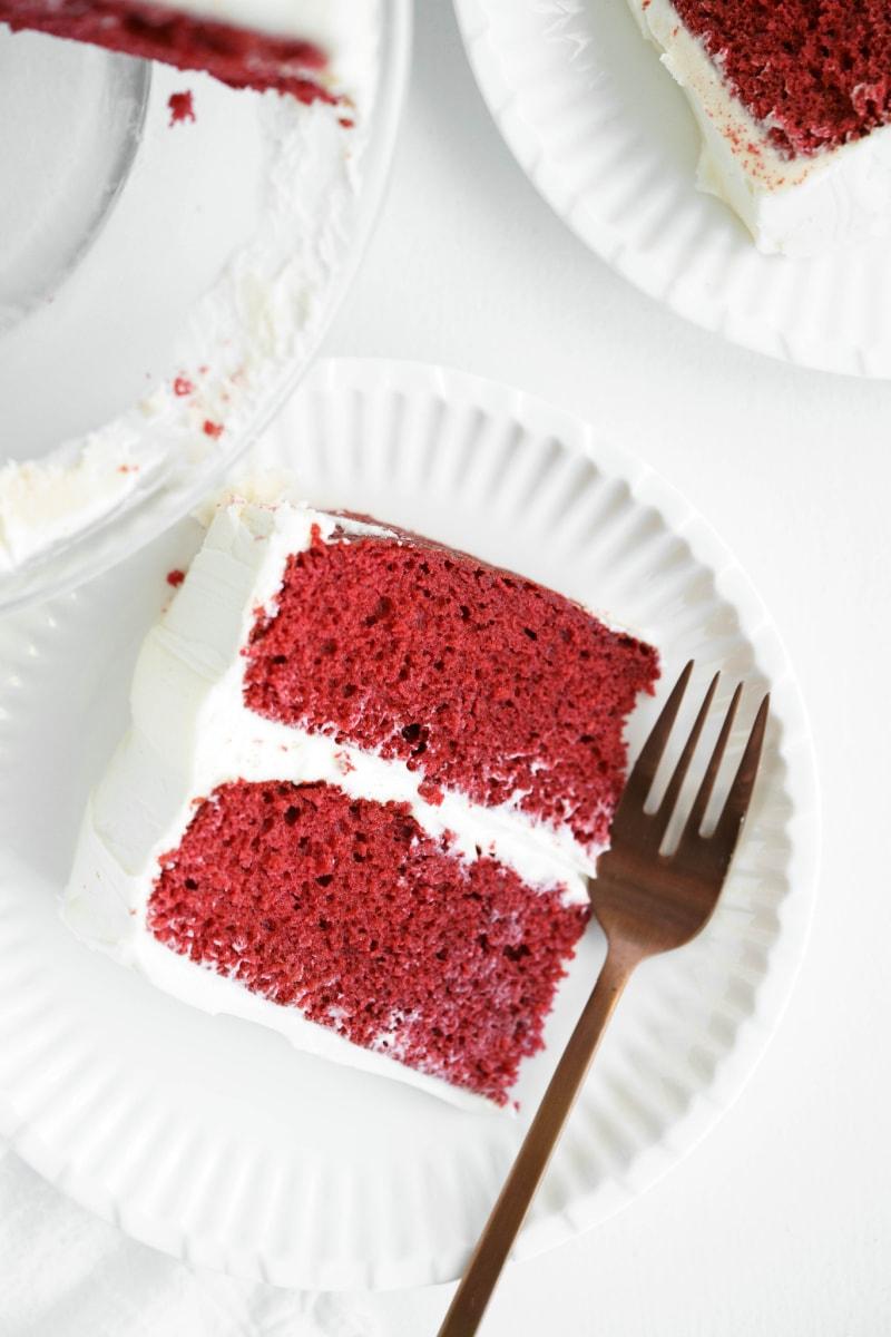 slice of red velvet cake on plate with fork