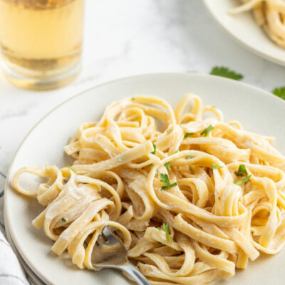 serving of fettuccine alfredo on a white plate