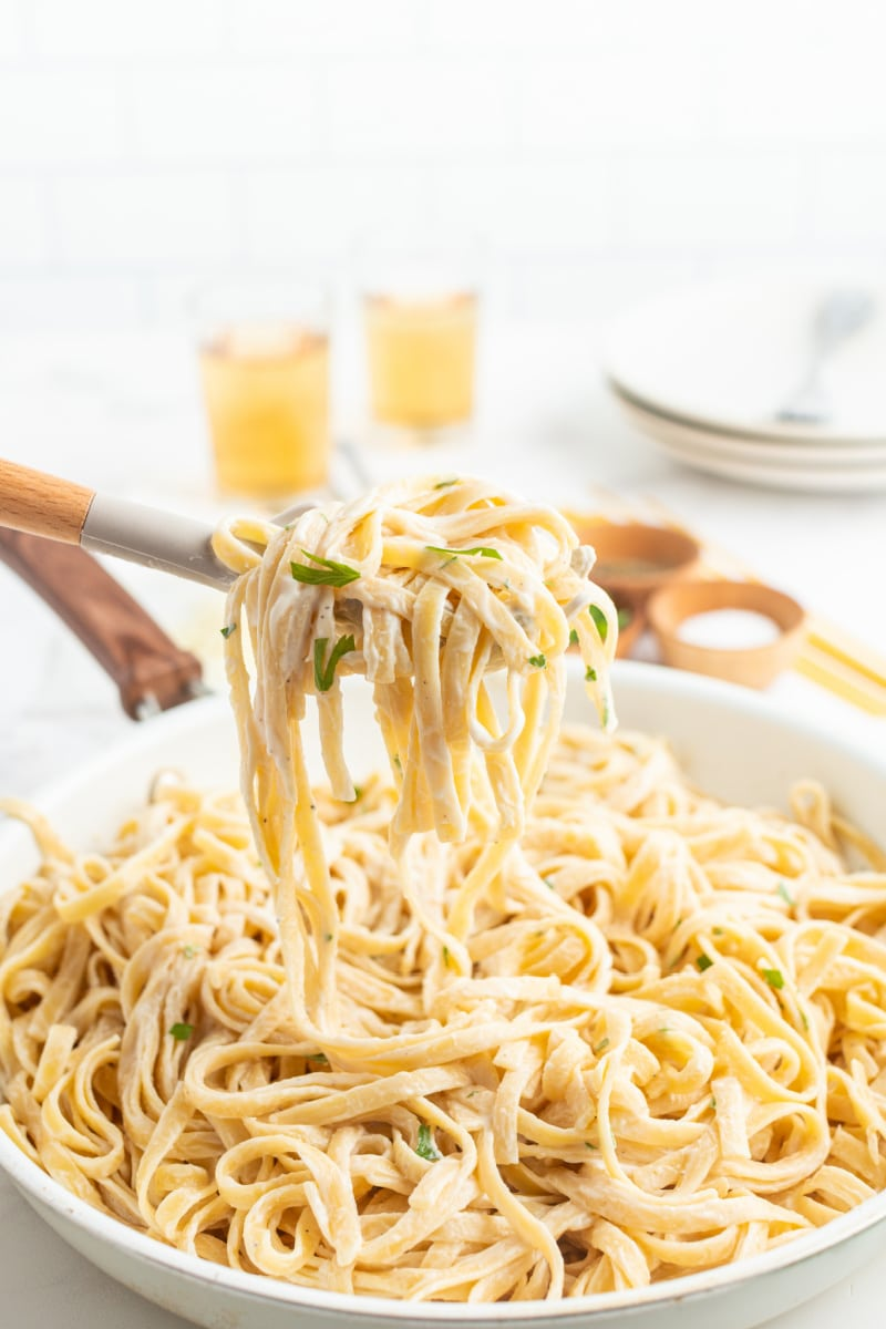 forkful of fettucine alfredo over dish
