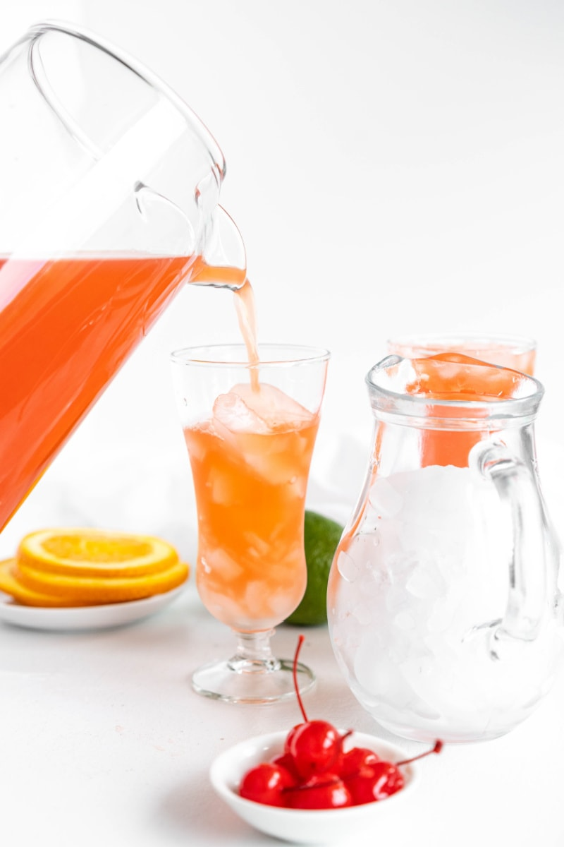 pouring hurricane punch into hurricane glass