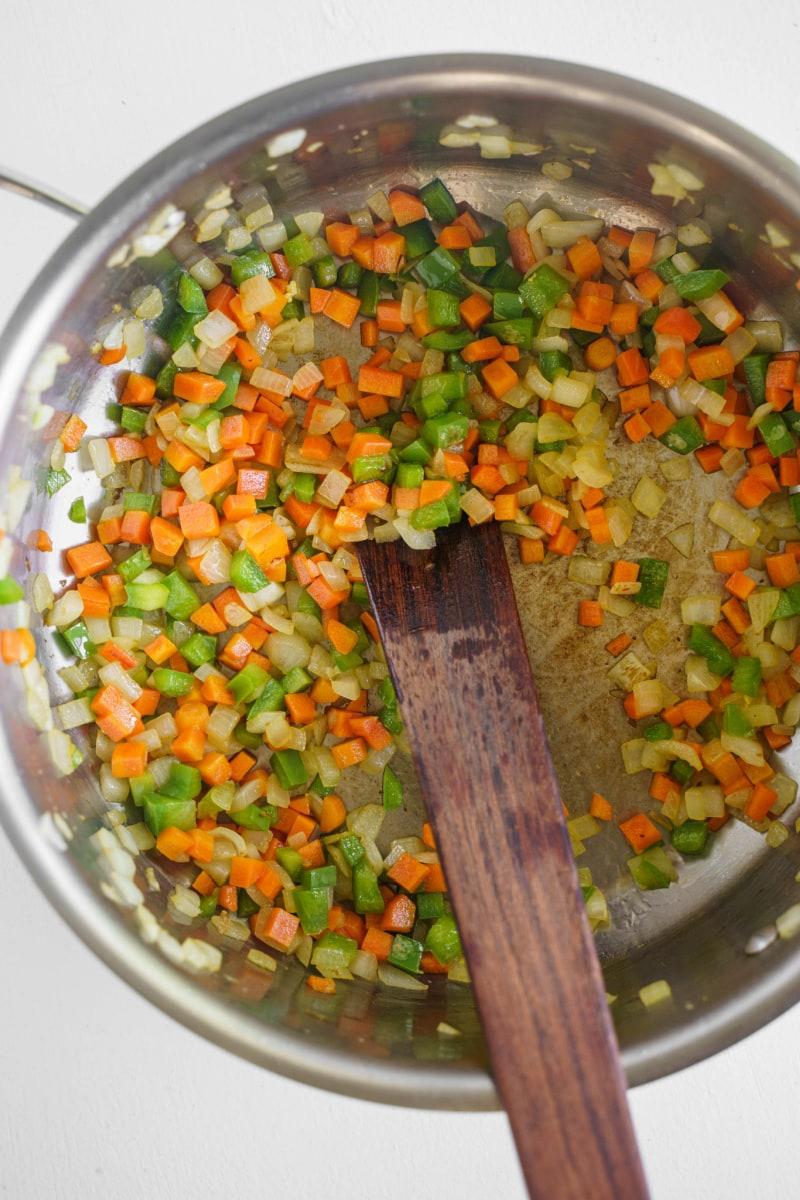 cooking chopped veggies in skillet