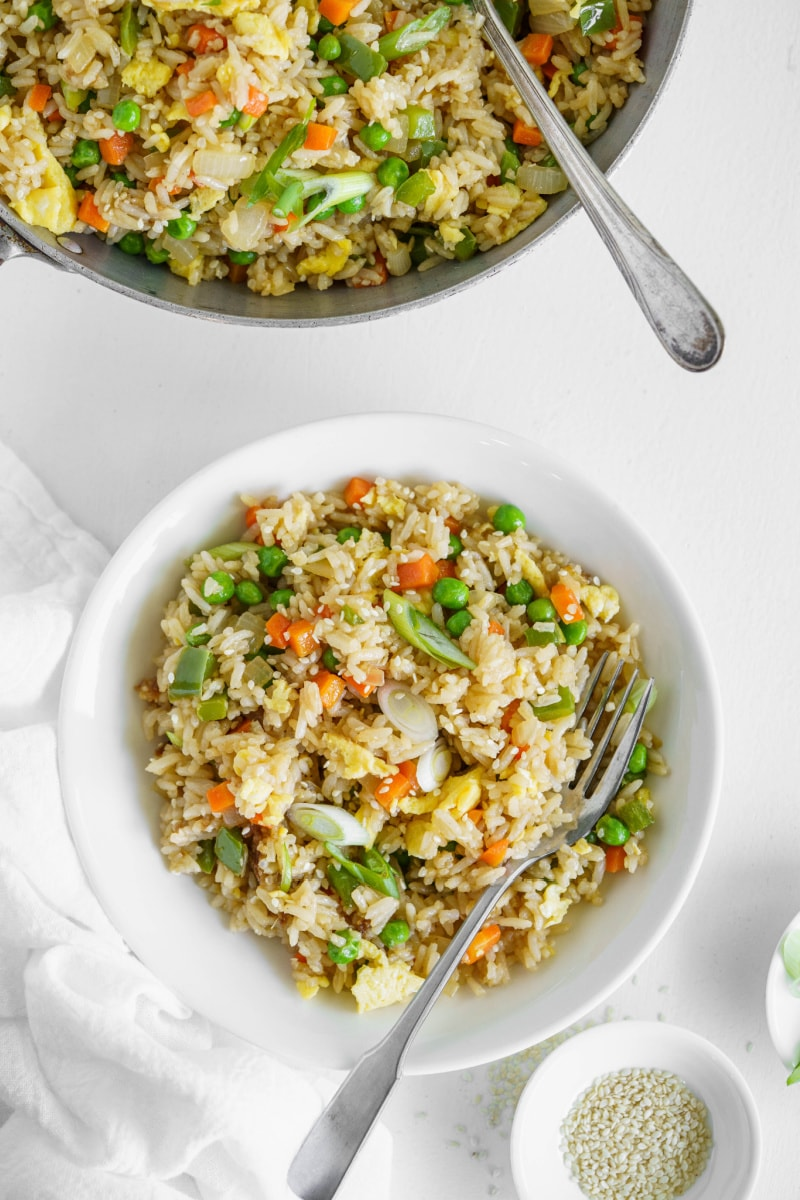 vegetable fried rice in bowl with fork