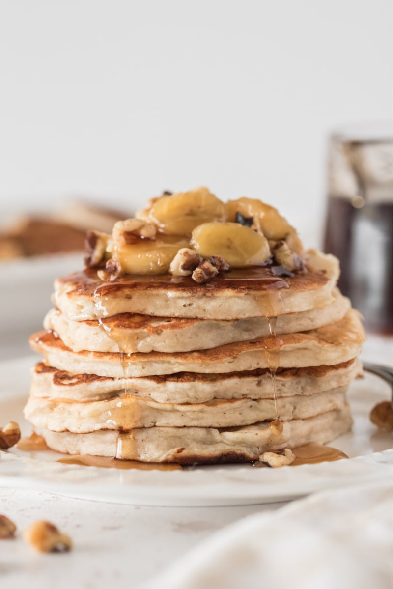 stack of pancakes with sauteed bananas on top