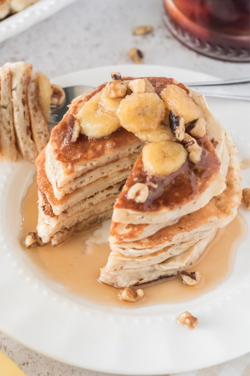 stack of banana bread pancakes with big slice taken out