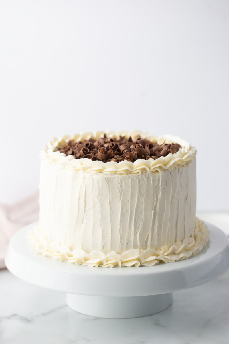 white wedding cake with chocolate shavings on top