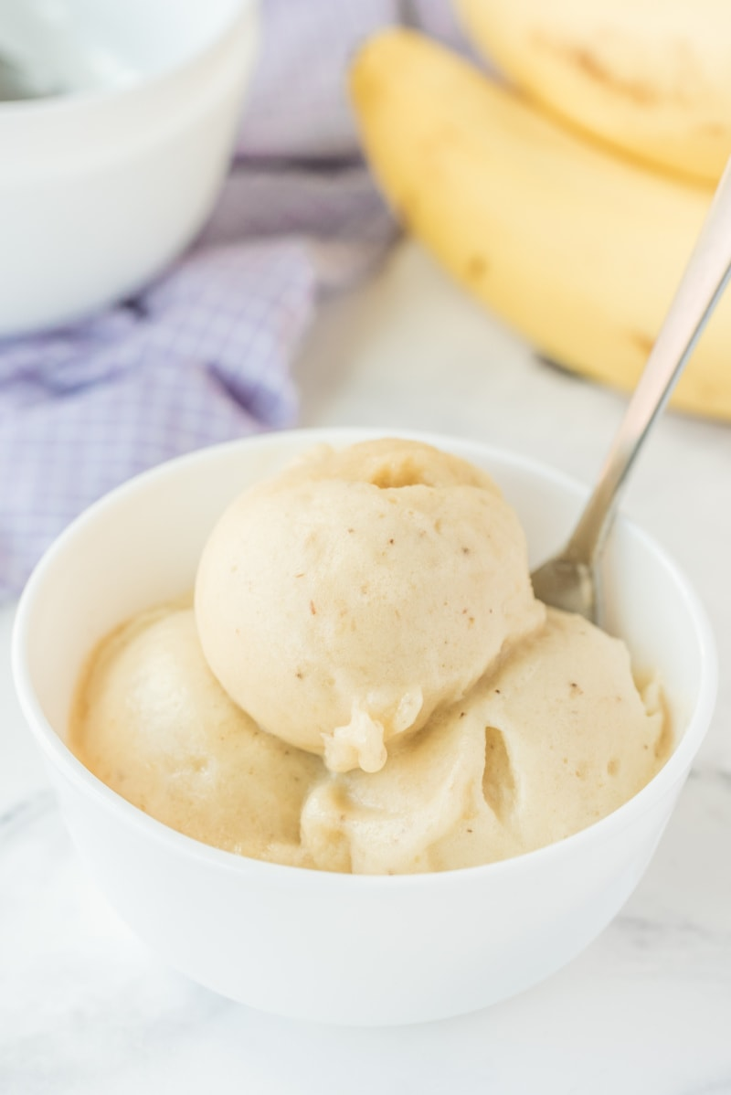 scoops of banana ice cream in a white dish