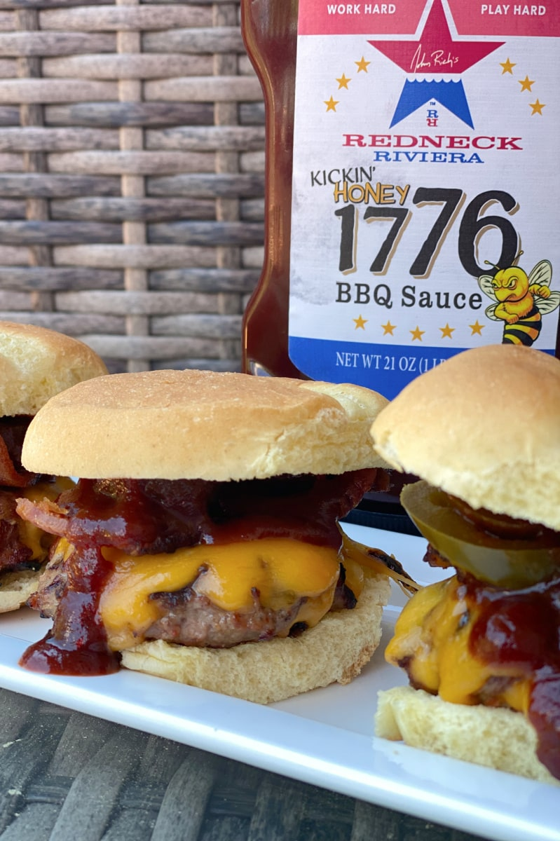 cowboy sliders on a plate with barbecue sauce