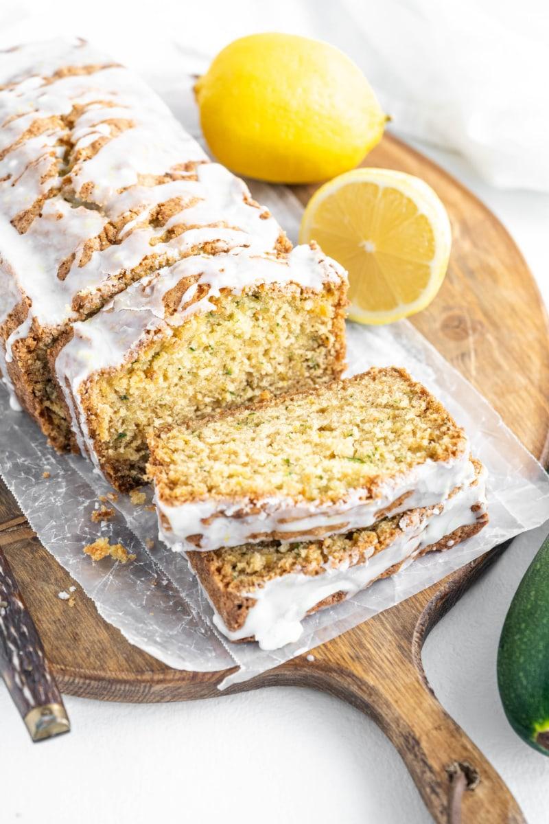loaf of iced lemon zucchini bread sliced