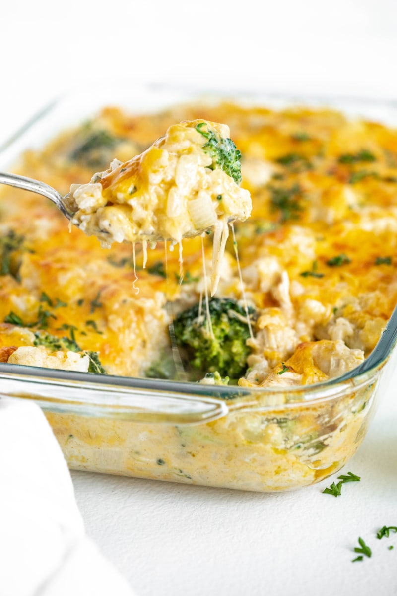 spoonful of chicken and rice casserole lifting out of dish